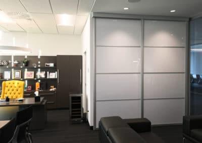 White hanging sliding doors in office