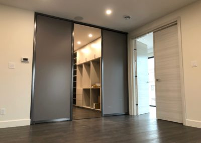 dark grey sliding doors for walk-in closet