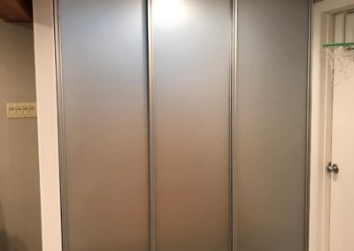 frosted glass room separating sliding doors