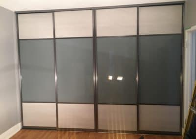 grey glass and melamine combination sliding doors for closet and room separation