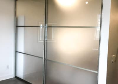 room separating suspended sliding doors frosted glass