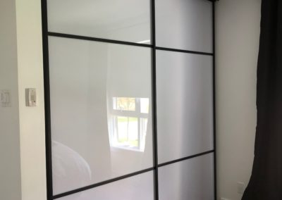 white acrylic and mat black framing closet doors