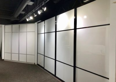 white acrylic sliding doors walk-in closet