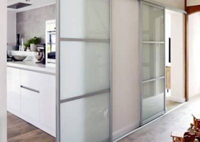 white glass room separating sliding doors